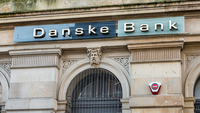 danske bank lowers negative rate threshold denmarks business minister says enough is enough